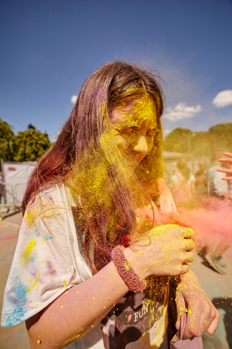 KALININGRAD, RUSSIA - JUNE 12, 2015: People with painted faces during the Holi Festival of Colors. Holi is a festival celebrated as a festival of colours